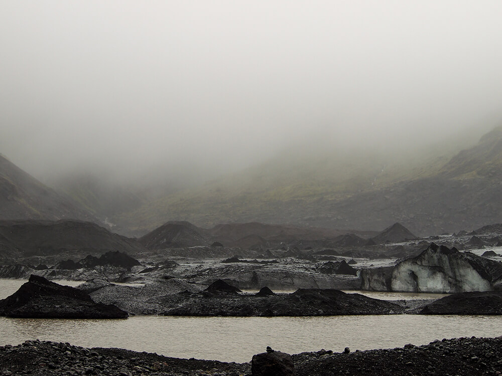 Travel photography of a very overcast rainy day visiting the glaciers in south west iceland