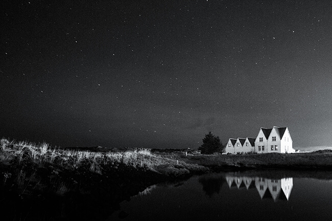 black and white images of houses in Iceland at night