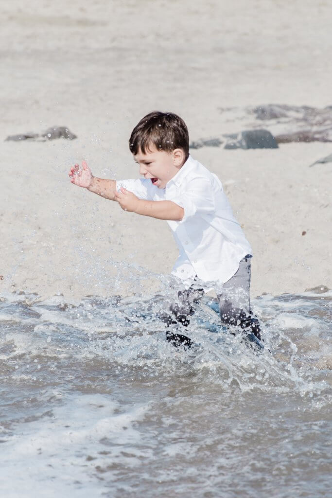 candids of baby boy during a family photography session at the beach in Sea Bright, NJ