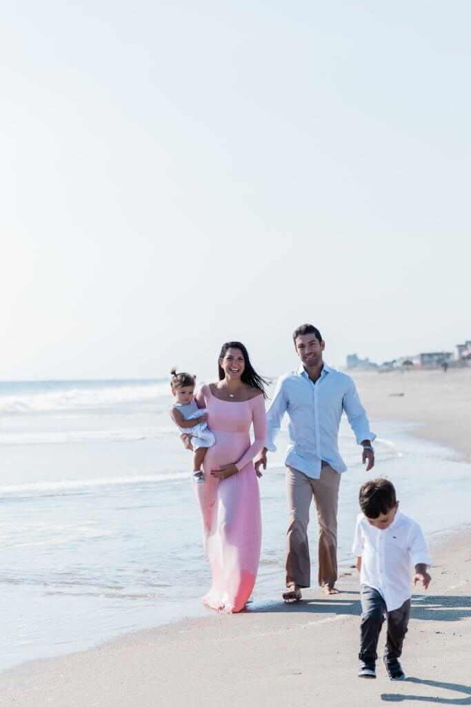 Image of family during Family Photography session walking along beach in Sea Bright, NJ