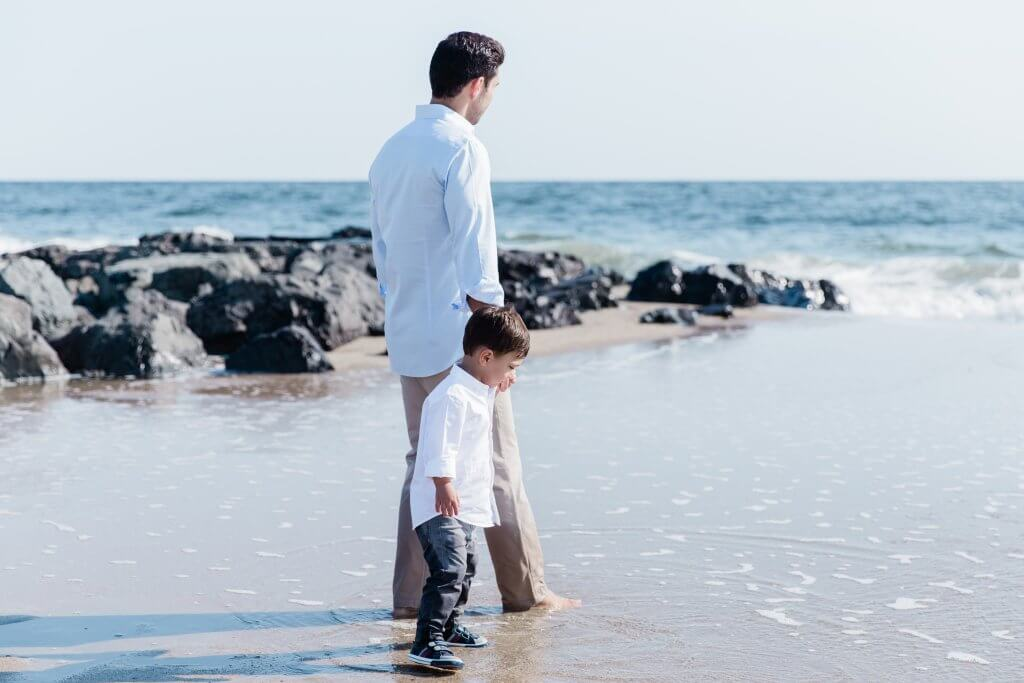 Image of Father and Son during Family Photography session walking along beach in Sea Bright, NJ