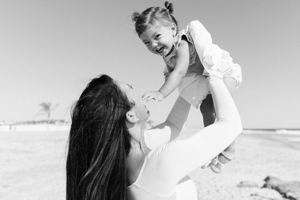 Black and White image of mom and baby at a beach photography session at Sea Bright, NJ beach